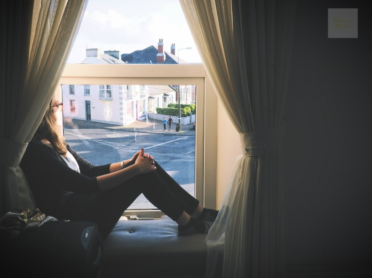 Sitta i fönstret vid världens ände